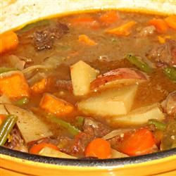 Mom's Portuguese Beef Stew With Extra-virgin Olive Oil, Beef Stew Meat, All-purpose Flour, Garlic, Bay Leaves, Ground Black Pepper, Salt, Onions, Green Bell Pepper, Carrots, Paprika, Fresh Tomatoes, White Wine, Water, Fresh Parsley, Red Potato, Sweet Potatoes, Green Beans