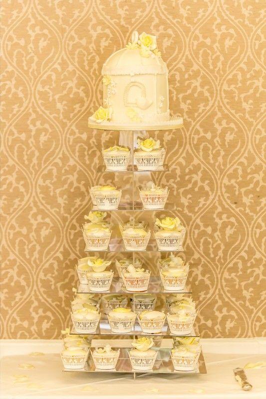 birdcage wedding cake with cupcakes. lemon, yellow