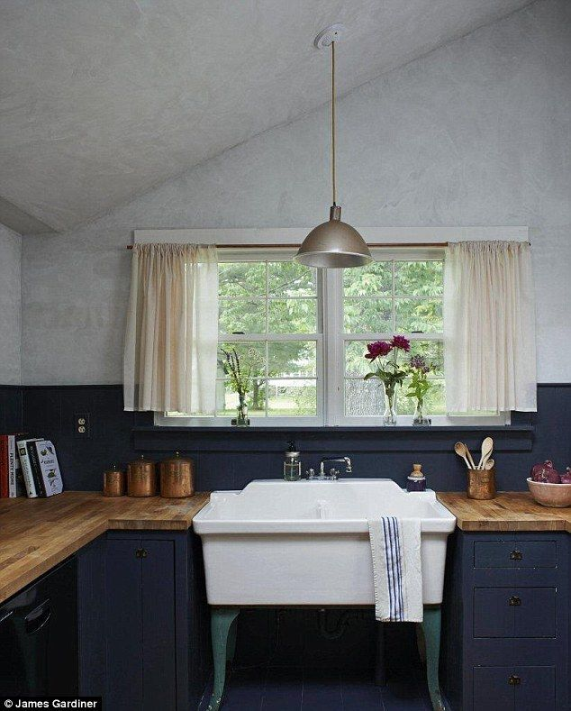 The farmhouse kitchen has a large vintage sink salvaged from a flower store, which has been custom-fitted into the existing cabinets. British Standard (britishstandardcupboards.co.uk) sells similar kitchens with a hand-painted finish