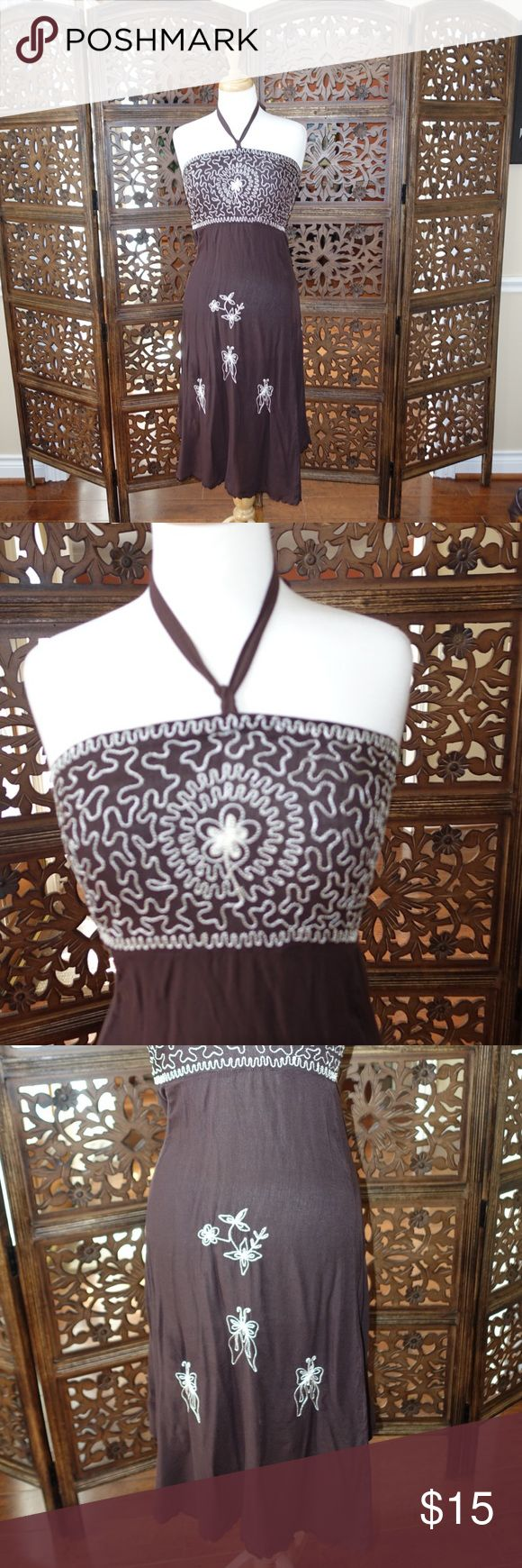 Beautiful brown beach dress 🌺 Beautiful brown dress with white embroided flowers and butterflies. It's one size so will fit a medium-large. You can wear at the beach, as a cover up or as a weekend comfy dress to go out shopping. Remember to bundle and save 10% on 2 or more items. 😊 Bluemar Dresses Midi