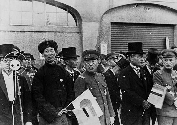 High officials of Manchukuo the puppet state set up by Japan in Manchuria at the pier to see Emperor Kwangte depart for Tokyo during the SinoJapanese...