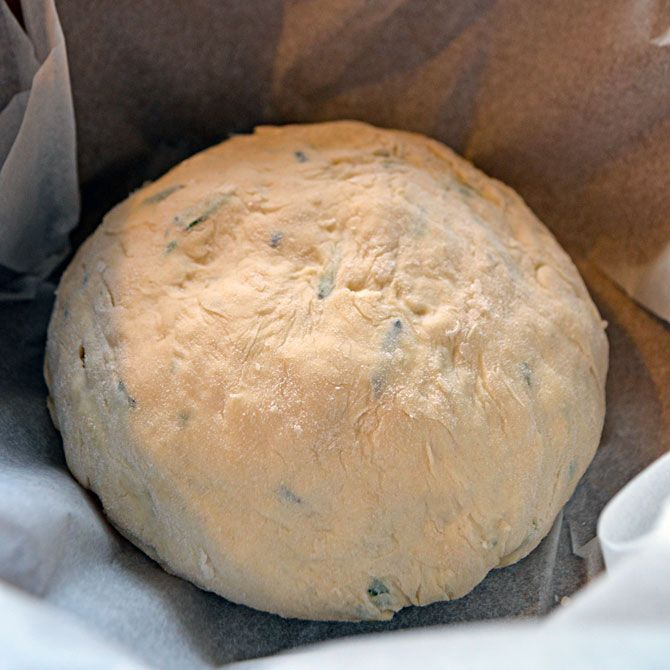 Rosemary Olive Oil Crock Pot Bread      3½ cups all purpose flour     1 packet dry active yeast (2¼ teaspoons)     1¼ cups warm water     ¼ cup fresh rosemary, chopped, divided     3 tablespoons extra virgin olive oil, plus more for drizzling     1 teaspoon sugar     1 teaspoon sea salt or kosher salt, divided