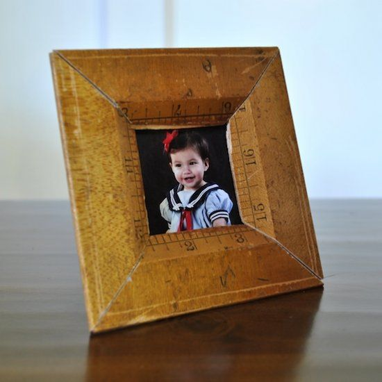 Learn how to make a cute picture frame from a vintage ruler for super cheap.