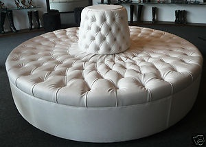 This might be cool in the foyer!   round tufted sofa chair, of course in a color though