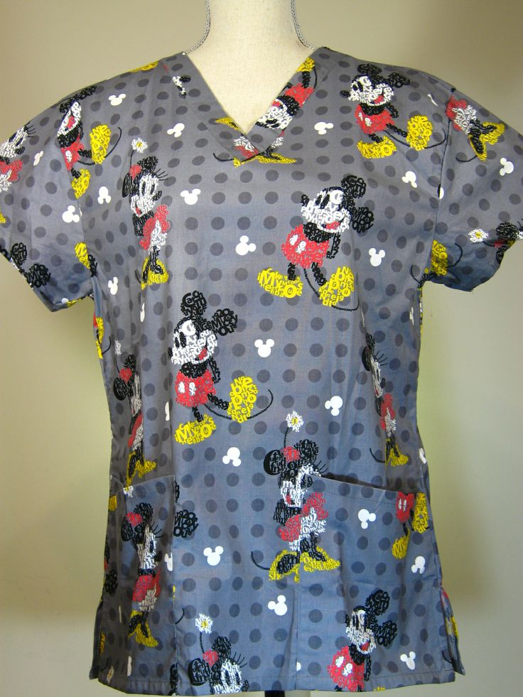 #caringplus scrub top - Mickey Graphics Gray - CaringPlus scrubs and uniforms - workwear clothing for nurses, caregivers and other healthcare professionals.  Perfect apparel for doctor, dental and optician offices, nursing homes, rehab centers, vet clinics, animal hospitals, or medical labs.