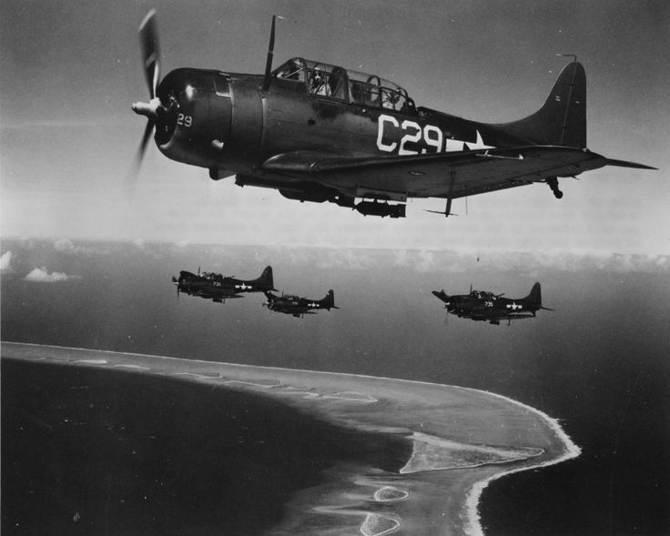 """American dive bombers SBD «Dontless"""" fly on the bombing of Enewetak Atoll"""
