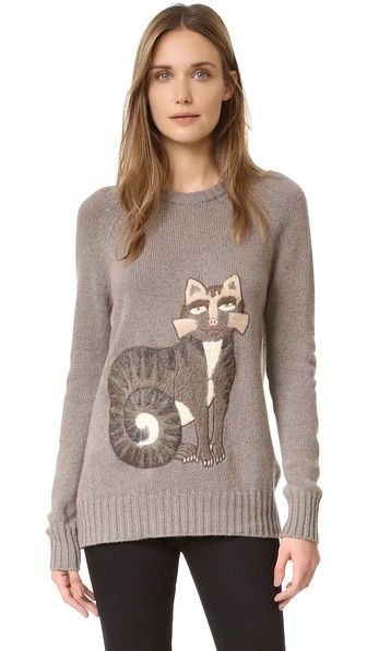 A brushed finish lends subtle texture to the cat graphic on this casual Tak. Ori sweater. Ribbed edges. Long raglan sleeves.
