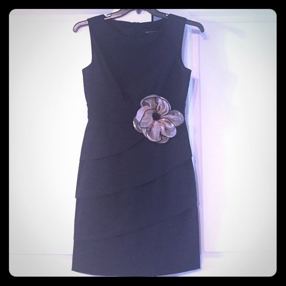 Cute Cocktail Dress for Wedding or Evening Event Cute black evening dress. Worn only once for a wedding. Gold accent flower with beads. Dress is made of polyester and spandex. Stretchy and comfy. Connected Apparel Dresses