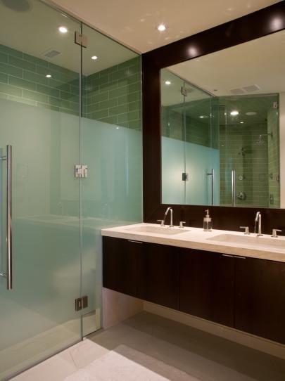 Neutral Bathroom with Walk-In Glass Shower and Dark Wood Vanity