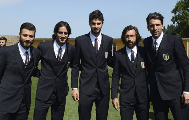Italian soccer team wears custom three-piece Dolce & Gabbana Martini Suits.