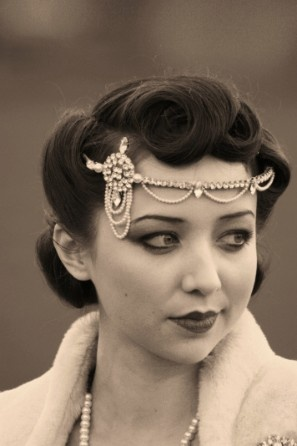 love the hair and the head piece. my idea of the perfect vintage look.