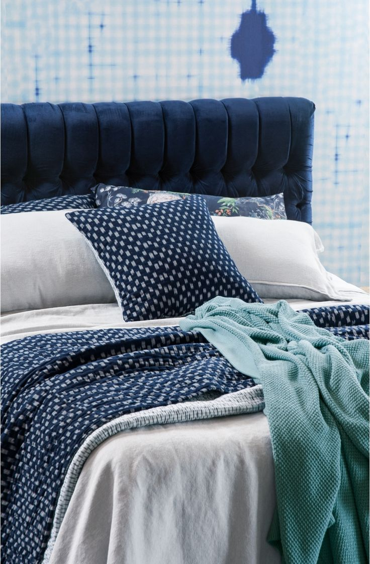 With a plain white bedlinen set you can use a bedspread in navy blue or more of a smoky aqua (both colours seen here).