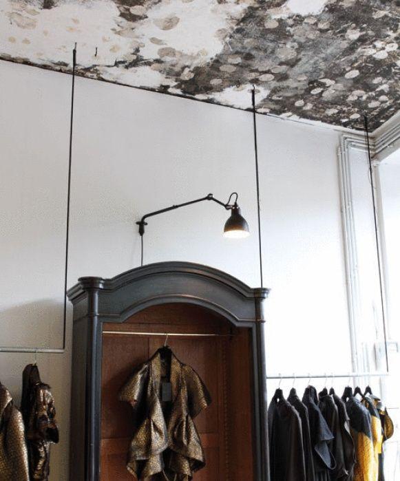 I love the single industrial light & armoire  Beautiful  xo--FleaingFrance