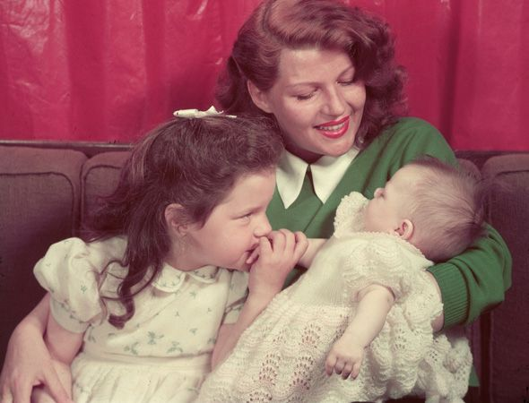 Rita Hayworth and Her Little Girls, Circa 1950 The stunning movie star and little Rebecca Welles, her daughter with Orson, stare lovingly at infant princess Yasmin. (Her father was Prince Aly Khan, vice president of the United Nations General Assembly representing Pakistan.)