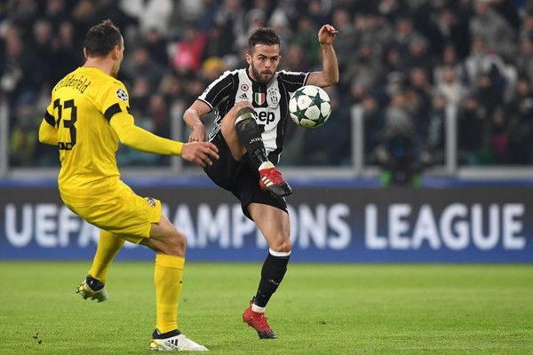 Miralem Pjanic (R) of Juventus in action agaist Gordon Schildenfeld of GNK Dinamo Zagreb during the UEFA Champions League Group H match between Juventus and GNK Dinamo Zagreb at Juventus Stadium on December 7, 2016 in Turin.
