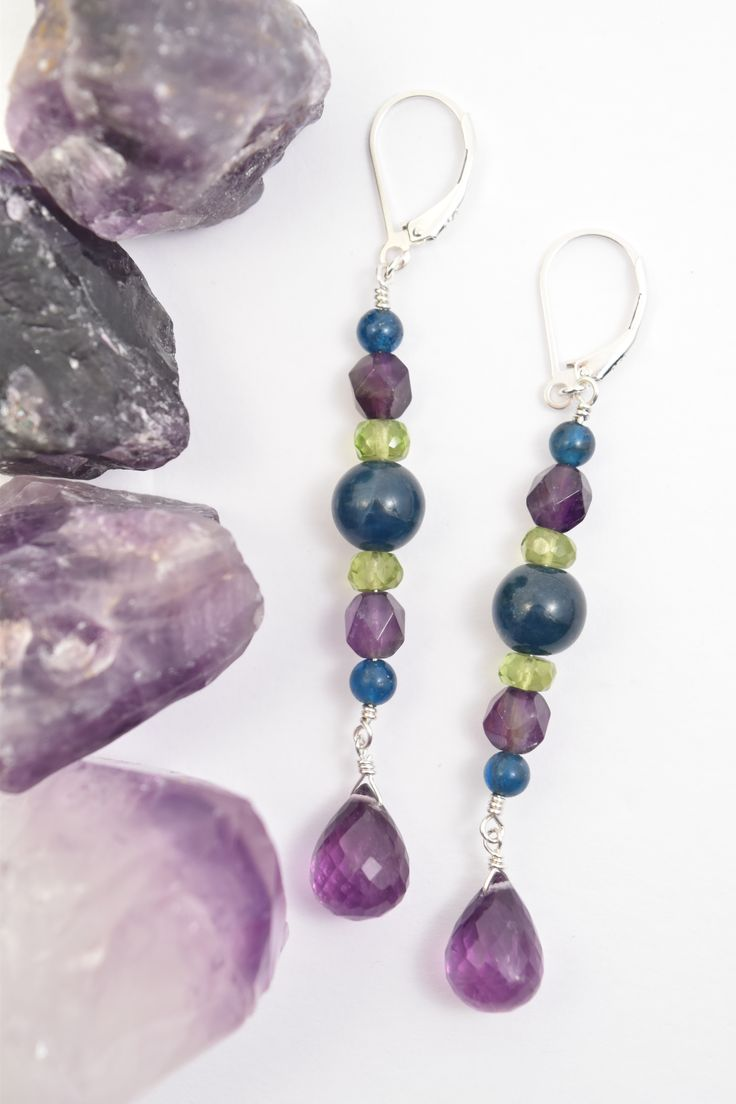 Natural Amethyst, Peridot & Apatite Dangle Boho Earrings.  A beautiful addition to any Purple & Green color palette. This crystal jewelry was handcrafted with expert finishing in Sterling Silver by: Love, Ludwiga - visit the store at: https://www.etsy.com/ca/shop/LoveLudwiga #crystaljewelry #loveludwiga