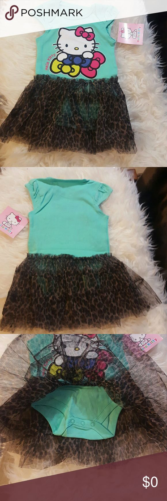 🍼🎀 Fun loving hello kitty ballerina style dress This fun, playful, hello tutu hello kitty dress is Ntw and fits baby 3-6months. The shirt portion of the dress is said turquoise color with sweet hello kitty on it. The shirt part is actual a onsee with snaps. The skirt is sown of  and layered with a suttel leapord pattern. Baby will look adorable in this iconic character based outfit. And the tutu part is leapord! Leapord!? What more can I say ;) Other