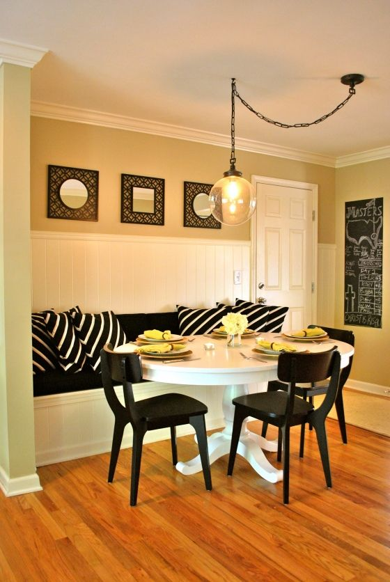 DIY Kitchen Banquette - i like how they showed you CAN use a round table, plus look how they moved their light fixture by using a swag