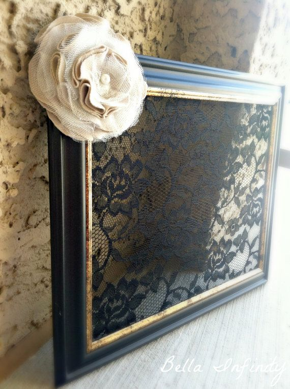 Love the black lace over the small chicken wire to hang earrings. Put hooks on bottom of picture frame for necklaces