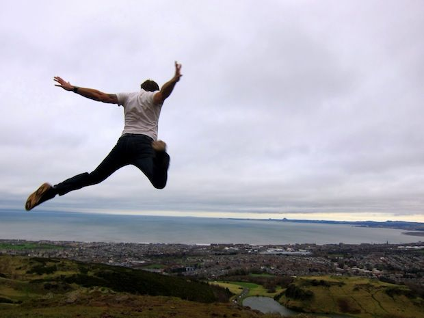 Epic jumping shot over Arthur's Seat, Edinburgh