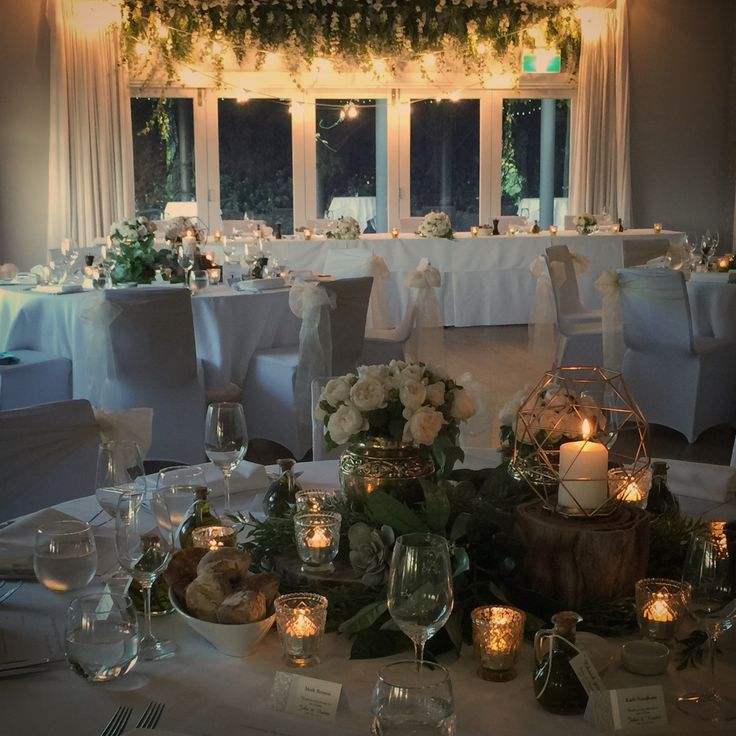 Wedding design, styling, decor and setting by When Love Sparks / @sparkdevents Fresh floral canopy above bridal table by Gai Hyde with swags of festoon lights by @sparkdevents Venue: Bells Killcare