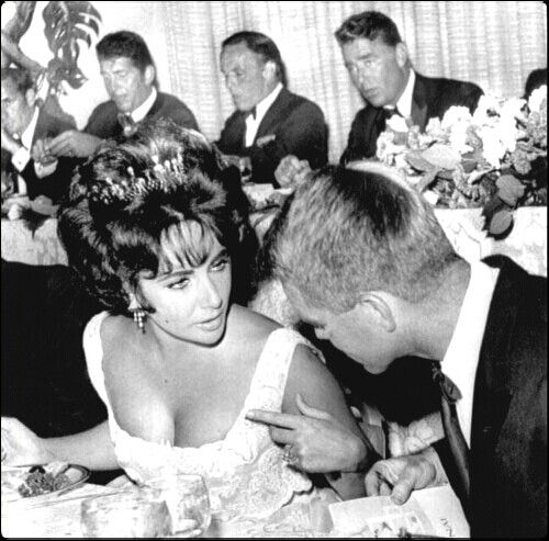 Elizabeth Taylor and Bobby Kennedy in front.Behind are Joey Bishop,Dean Martin,Frank Sinatra and Pete Lawford