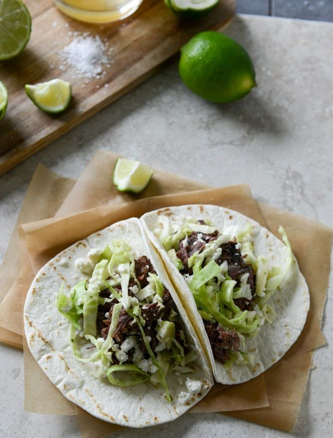 crockpot short rib tacos w/ salted lime cabbage  queso fresco.