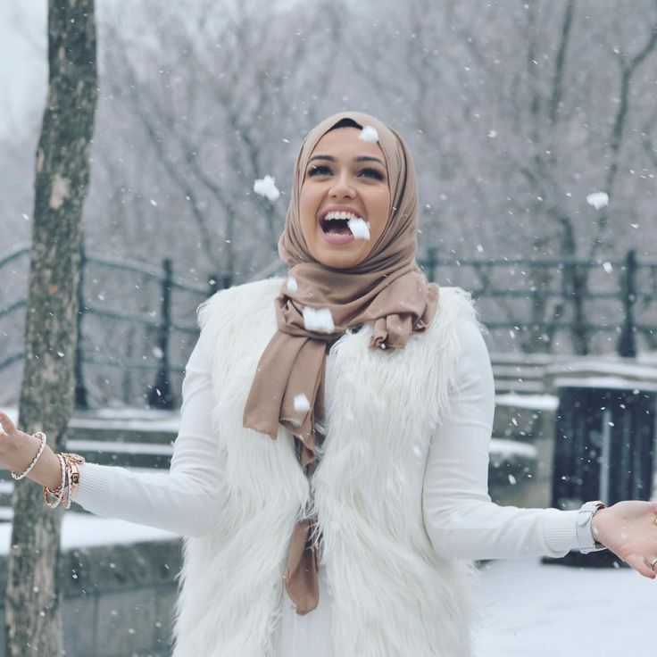"""Clearly I was way too happy to be throwing packing snow in the air......... #throwbackthursday #latergram @elle.vation is having a sale 10% off all hijabs…"""