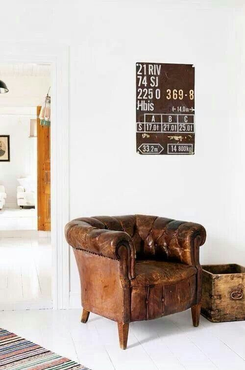 Tan Distressed Leather Of This Chesterfield Armchair Goes Beautifully  Against Stark White Walls