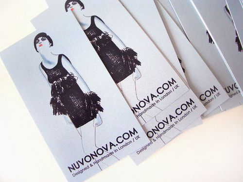Nuvonova - This single-sided business card is for a handmade upscale fabric store in London, UK.
