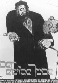 """Poster realizzato nell'ambito della mostra anti-semita """"Der ewige Jude"""" (L'Ebreo Errante) e raffigurante gli Ebrei come marxisti, usurai e schiavisti. Monaco, Germania, 8 novembre 1937."""