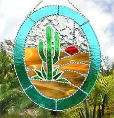 Cactus Stained Glass Suncatcher -  This suncatcher is hand cut from high quality, American made, stained glass. It is constructed in the Tiffany method, meaning that each cut piece of glass is wrapped with copper foil and hand soldered to the adjoining pieces. As a special finishing touch, a very special decorative solder work in applied by hand, giving a sparkling finish to the sun catcher. by StainedGlassDelight on Etsy, $49.95