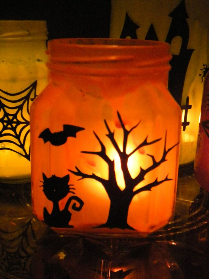 DIY Halloween Light Ups: adorable luminary jars. Love the spooky cute silhouettes. Here are the super bright & long lasting LEDs to LIGHT 'EM UP: http://www.flashingblinkylights.com/ledsubmersiblecraftlights-c-114_462.html