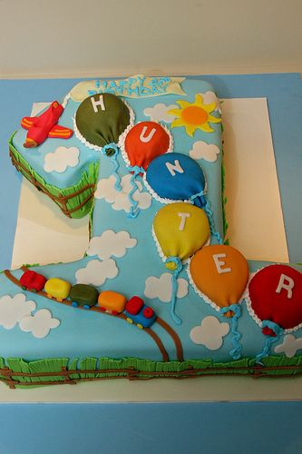 Number 1 first birthday transportation cake with balloons, so cute!