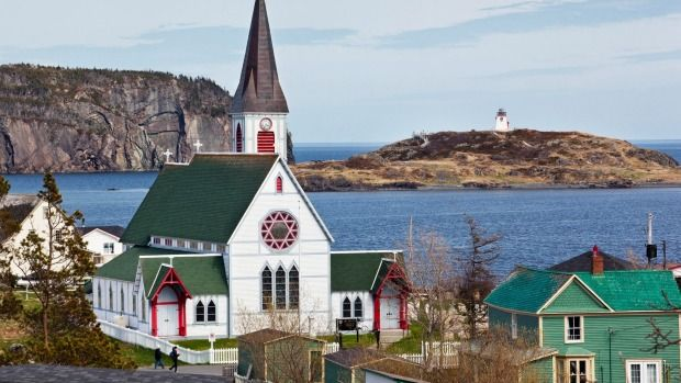 St. Paul's Anglican Church (foreground) and Fort Point Lightouse (background).Photo: Robert Chiasson