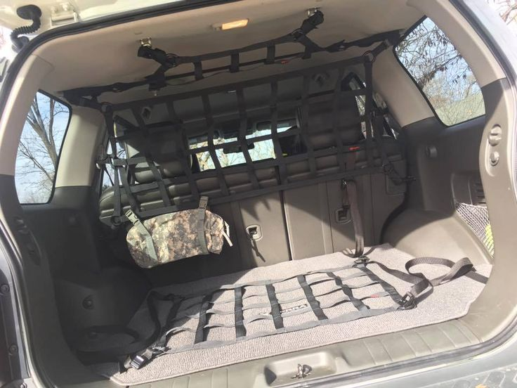 Dave's #nissanxterra #pro4x is set up for some serious #offroading!  Nicely done in there! Rear seats fold flat for longer items to pass through if needed.  Go #outdoor #4x4 #overlanding #adventureawaits #huntinggear #xterranation #xterraoffroad #xterraperformance #ruggedrocks #rainglernet #outdoorlife #huntingdog #dogsincars #dogsintrucks #strappedin #cargonet #madeinusa #builtincolorado #handmade