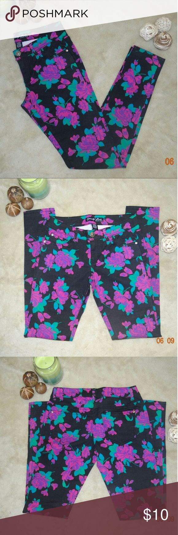 Celebrity Pink Black Floral Pants This item is brand new. Celebrity Pink black floral print skinny pants in woman's size 5. Please note camera had difficulty picking up true colors its pink and purple floral. Very cute alternative to the black skinny pants. Celebrity Pink Pants Skinny