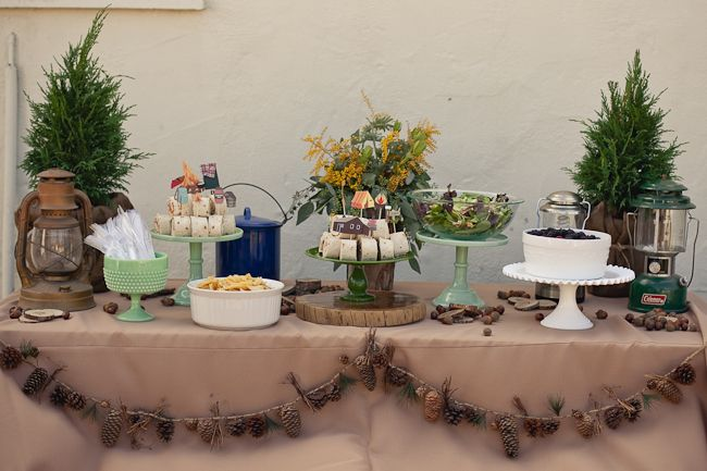 This is actually a camping-themed baby shower! I love the pinecone/pine needle garland, sandwich rollups that look like log slices & dirt jar desserts.