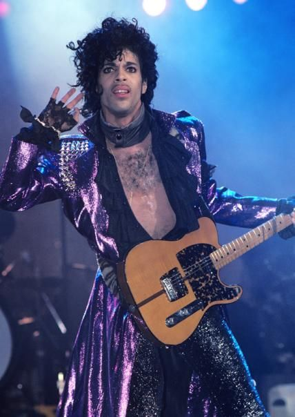 Prince's 15 Most Iconic Purple Outfits - November 28, 1984 - from InStyle.com