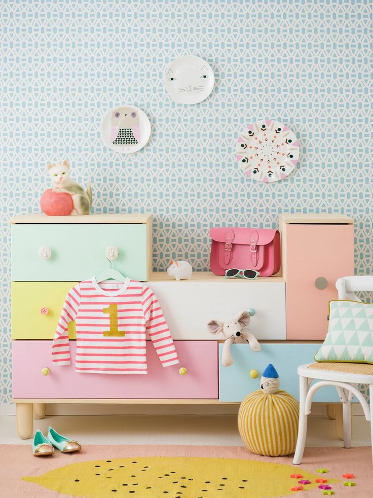 Love this sweet little dresser and the colors for a kids' room.