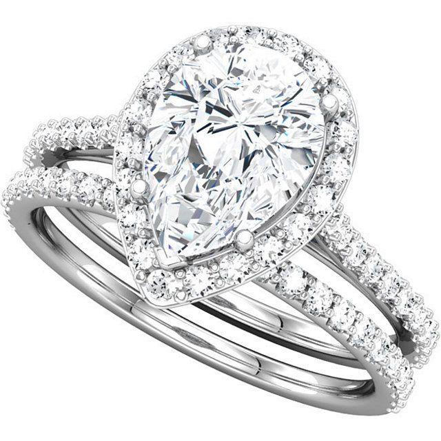 Custom White Gold Pear Shape Cut Diamond Halo Moissanite Engagement Wedding Anniversary Ring. $1,350.00, via Etsy.