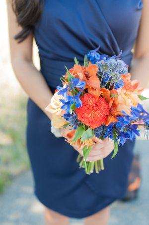 Blue and Orange Bridesmaid Bouquet | photography by www.bluerosepictu...