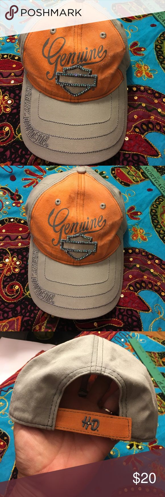 Harley Davidson Hat. New. Gray and orange ladies hat by Harley Davidson. Pretty crystal blinged bar & shield. Adjustable strap in back. New no tags. Has NOT been worn. Harley-Davidson Accessories Hats