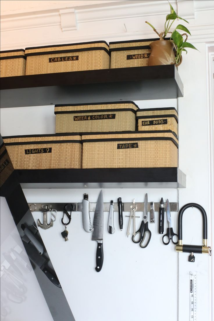 Magnetic tool bar and art supplies boxes beside the drawing table.