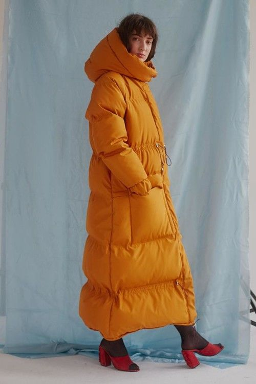 630 USD. Long down coat with a hood. down jacket with natural fluff of gray goose, fill power 750.