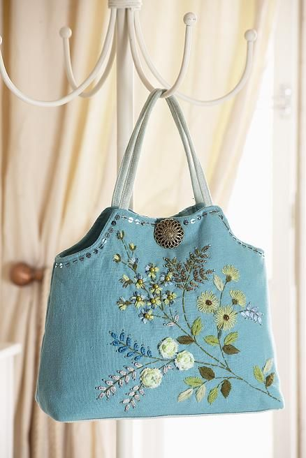 Beautiful colour and love the embroidery/applique on this bag