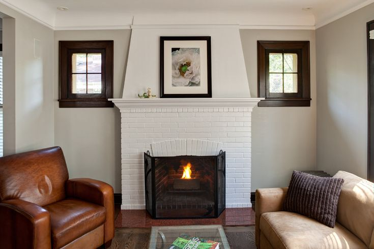 painting brick fireplace Traditional Living Room Decorators Chicago day room fireplace screen glass coffee table leather club chair living room painted brick recessed lighting tan sofa white brick wood trim