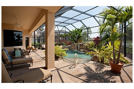 A lushly landscaped pool with a rock waterfall and for Landscaping rocks fort myers fl