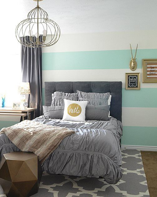 Jennifer of Tater Tots & Jello turned a dark bedroom into a fun, bright, and happy guest bedroom with a gorgeous color scheme of aqua, gray, and gold! #craneandcanopy