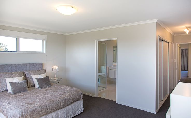 This G.J. Gardner Home boasts a large master bedroom with lots of built in wardrobe space and a spacious ensuite.
